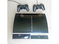 Playstation 3 with 7 games, 2 controllers