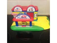 Garage, and fast food shop. (Could link to Happyland)