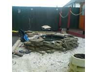 pond with slate and water proof encasing
