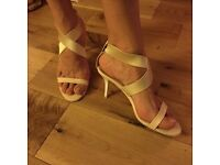 Nude/cream sandals by DKNY
