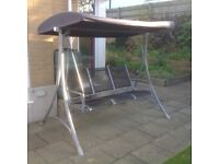 Three seater garden swing seat in good condition - only reason for sale is moving to a flat