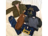 Bundle of baby boy clothes aged 6-9 months.