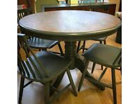 Lovely refurbished dining table and four chairs