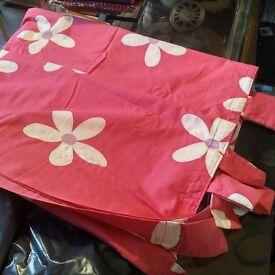 Pair of pink tab-top curtains