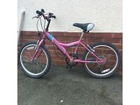 Pink girls bicycle - to suit ages 6-8