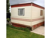 Mobile home package - mobile home, oil boiler and tank and garden shed.