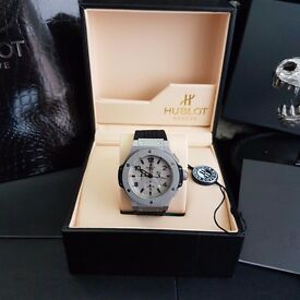 Grey faced Hutlot Fusion big bang. With metal casing and black canvas strap comes hublot boxed