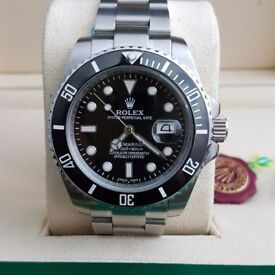 Silver Rolex Submariner Black Bezel and black face, Comes Rolex Bagged and Boxed with paperwork