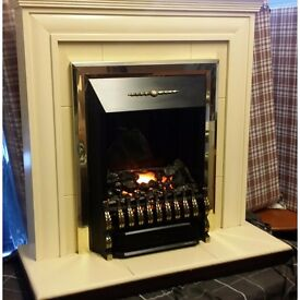 Lovely Electric fire with surround in very good condition.
