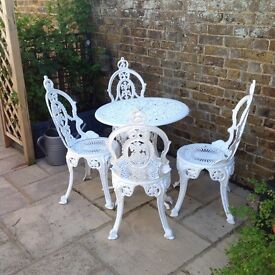 White garden table and chairs