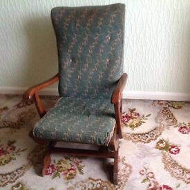 Upholstered rocking chair very well sprung in good condition