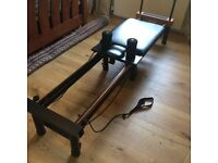Pilates performer machine with a stand