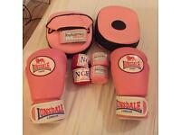 Female boxing gloves with pads and raps.