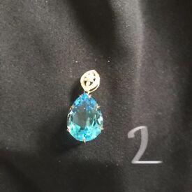 9K gold blue topaz pear shape pendant