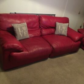 Large red sofa and chairs