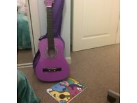 Purple girls guitar and book