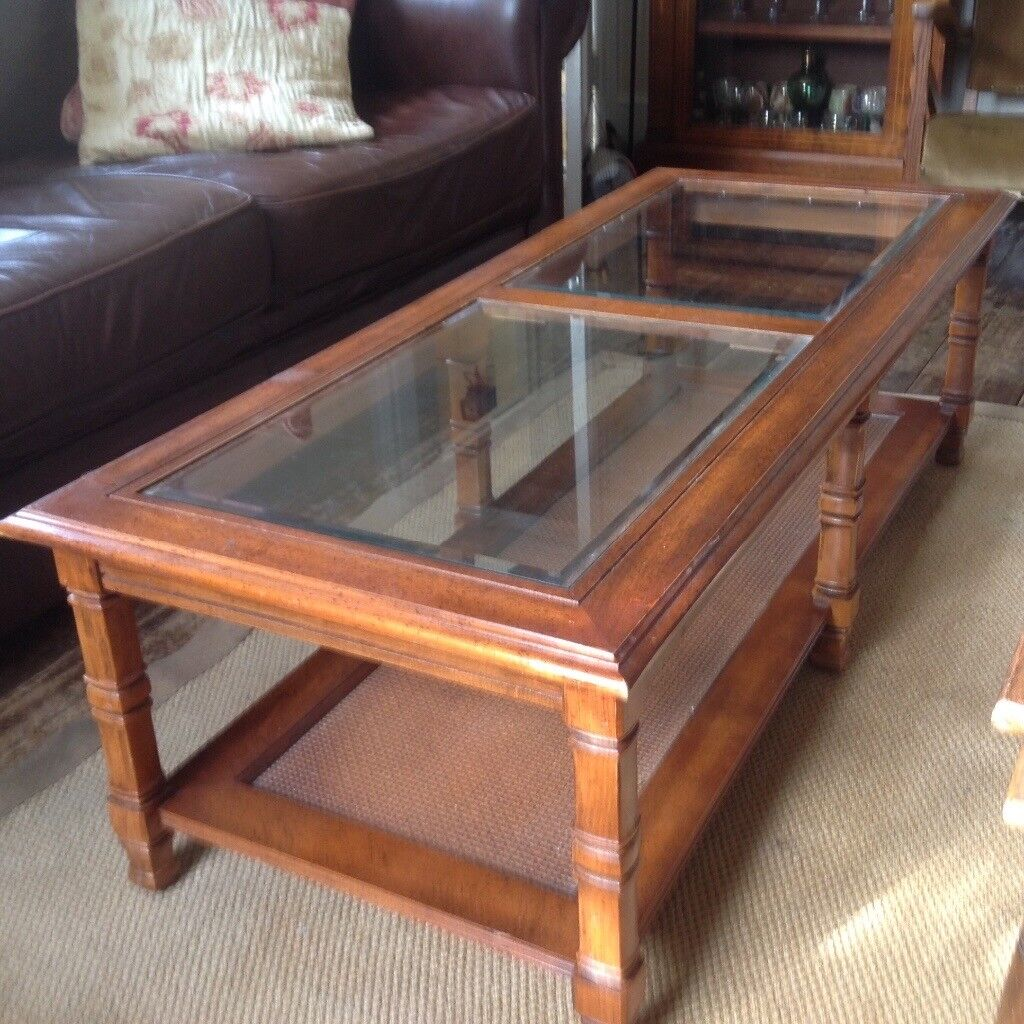 Coffee table large wood table beveled glass top and handy shelf underneath