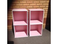 4 Pink storage boxes.