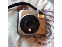 Instax Mini 70 Polaroid Camera in Gold - Pristine Condition.