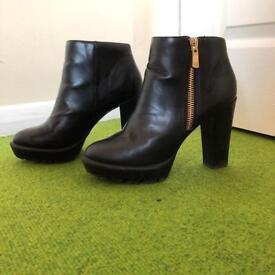 Black zip boot heels