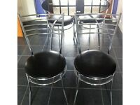 Glass top kitchen table and four chairs.