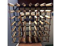 Wine rack holds 36 bottles
