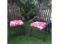 Four hardwood garden chairs for sale