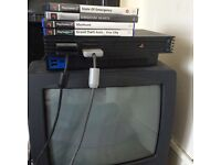 Classic PS2 with vintage tv to play on , wires , games and two controllers