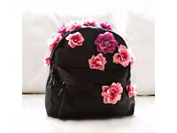 Black bag with flowers