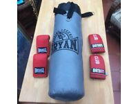 Bryan punch bag, 1 pair of Bryan & 1 pair of Lonsdale boxing gloves. Hardly used