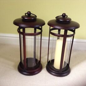 Two large glass candle lanterns for indoor or garden