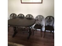 Extending dining table and 6 spindle back chairs