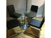 New Glass Dining table and 4 Chairs. Negotiable Price