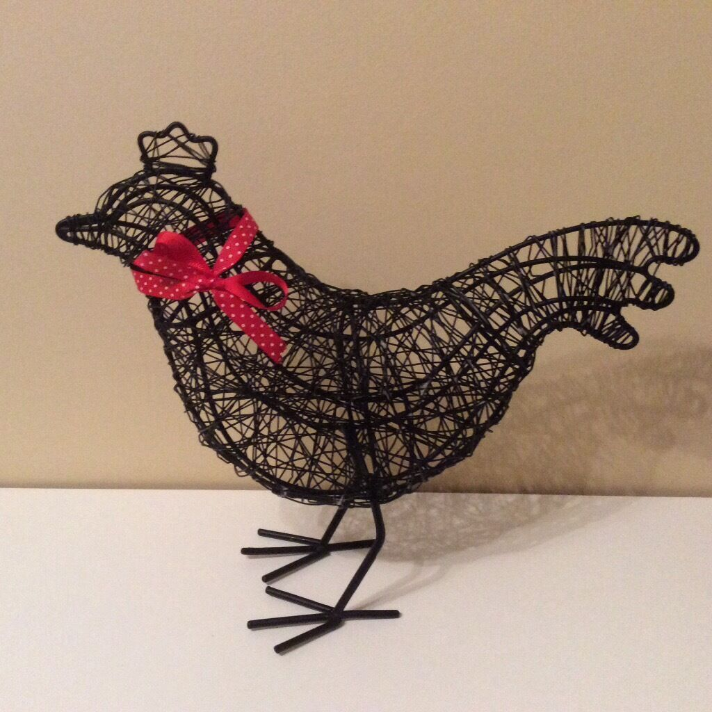 Ornamental metal chickenin Llanedeyrn, CardiffGumtree - Black metal ornamental chicken with red spotted ribbon. As new condition. Not small. Great looking