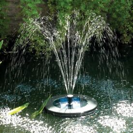 Floating solar powered pond fountain with LED lighting to illuminate at night
