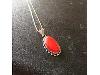 Ladies sterling silver pendant with a coral stone hallmarked 925