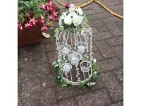 Bird cages decorated for wedding tables