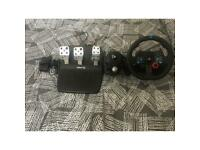 Logitech G29 steering wheel with pedals and shifter