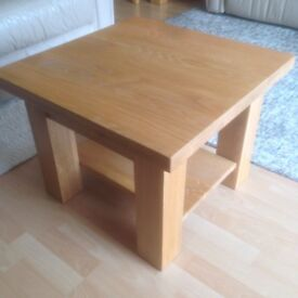 Small solid oak coffee or side table.