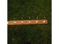 Free 6 coat hooks on wooden frame.