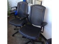 Herman Miller celle chairs with black leather seats
