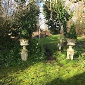 2 stone garden urns on bases £150 each
