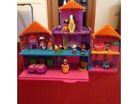 Dora castle , 3 houses, truck 8 figures and some furniture -offers