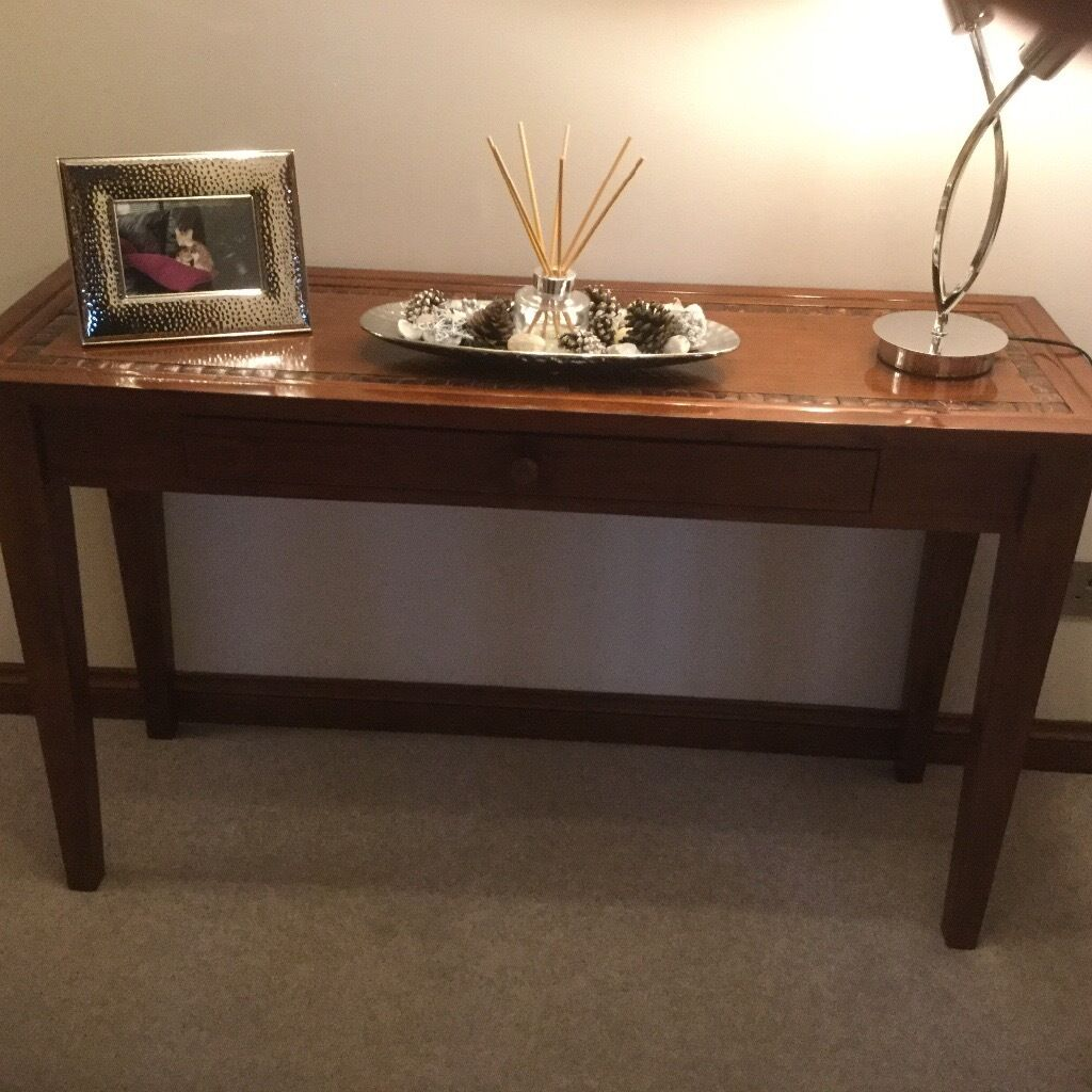 Console table in dark woodin FalkirkGumtree - Console table in dark wood. Couple of small marks on wood. Includes a drawer. Perfect for in a hall. 1.4m long and 0.41m wide. Also posting a separate add for matching tel table