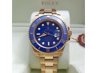 Gold with blue face Submariner Rolex. Complete with Box, Bag & Paperwork.