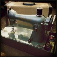 Antique portable powered sewing machine
