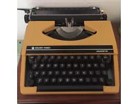 Vintage typewriter, in good working condition for sale.