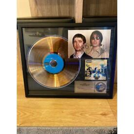 Signed definitely maybe gold disc