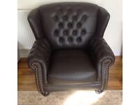 Leather winged back armchair