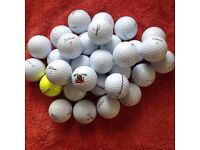 30.mixed titleist golfballs in good condition.